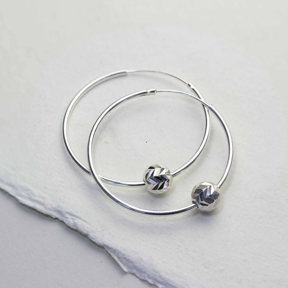 Sterling Silver 22mm Hoop Earrings with Chevron Cut Ball Beads