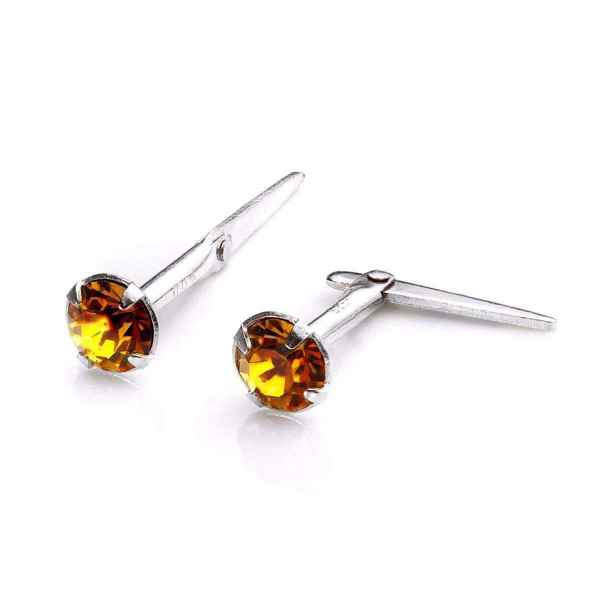 Sterling Silver Andralok Stud Earrings with 3mm Topaz Crystal